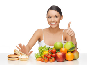 woman with fruits showing thumbs up